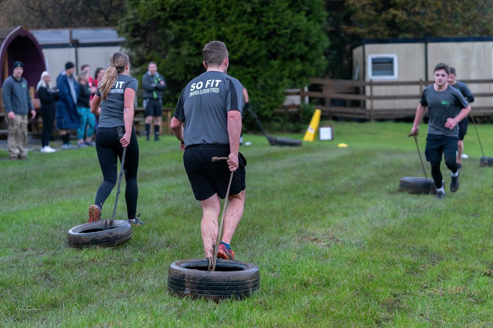 CORPORATE TEAM BUILDING TYRE PULLING