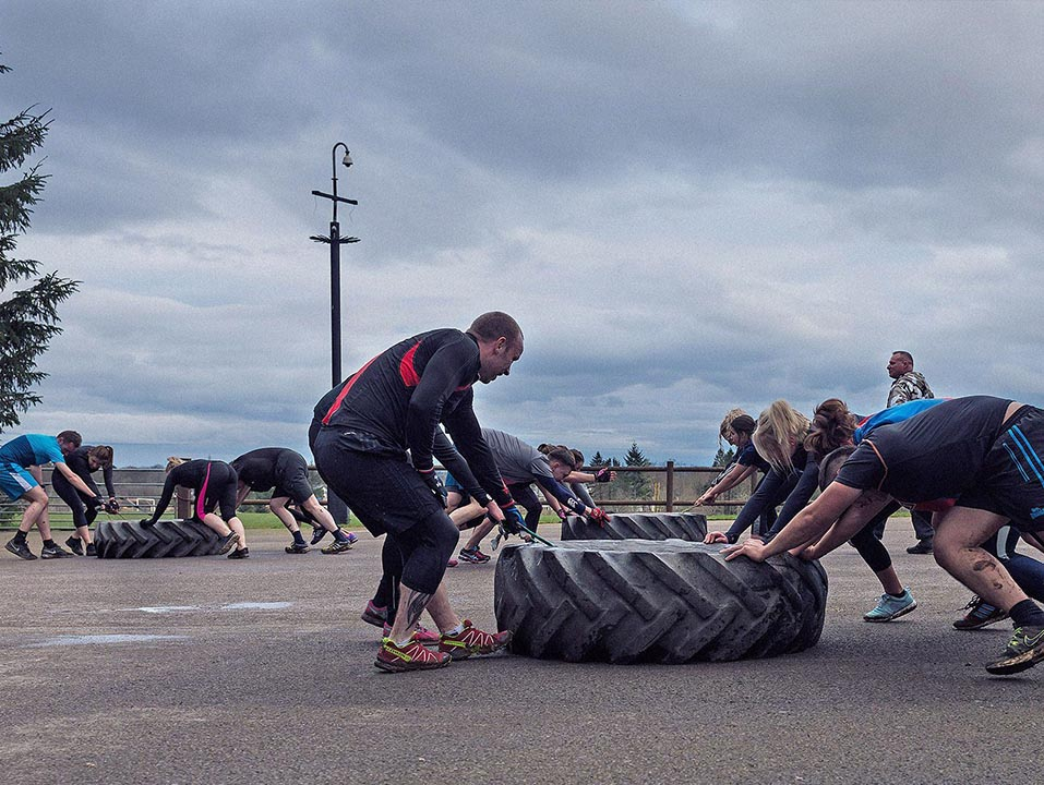 CORPORATE TEAM BUILDING TYRE PUSHING